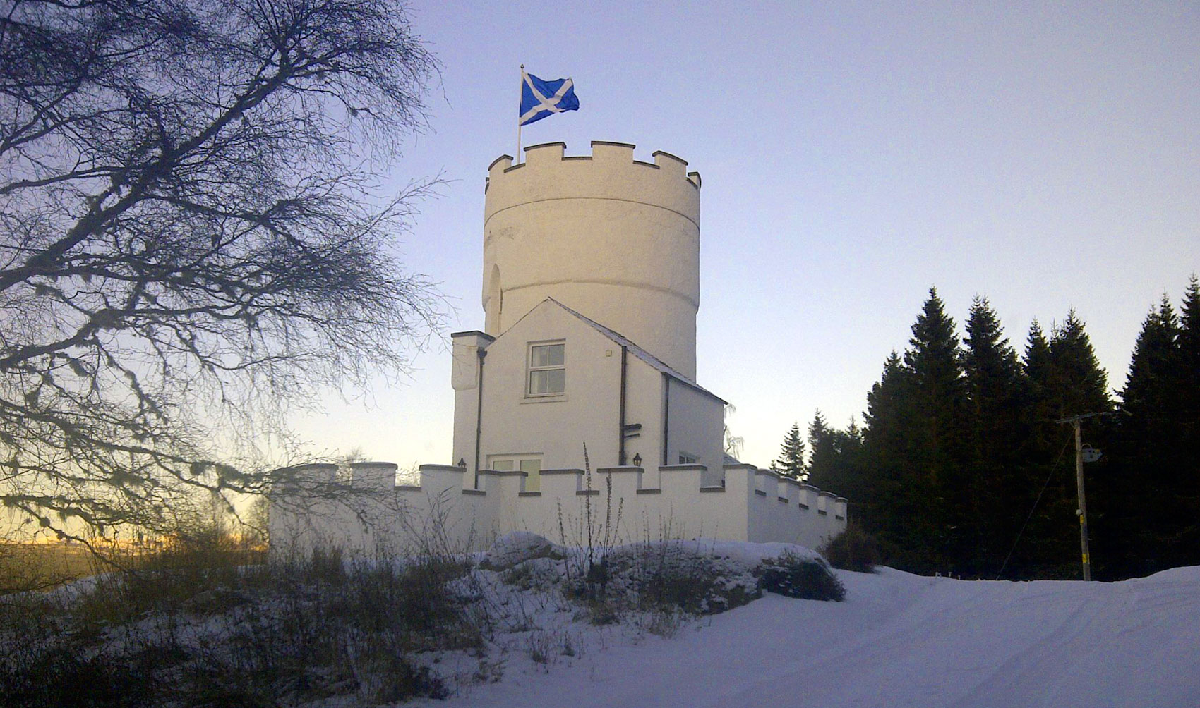 The White Tower in the snow with Scottish flag
